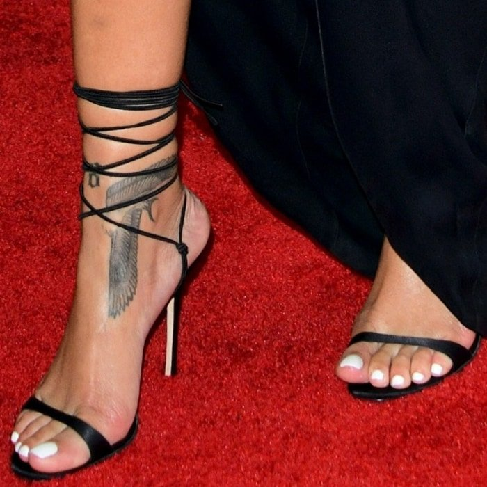 Rihanna's large Egyptian falcon foot tattoo