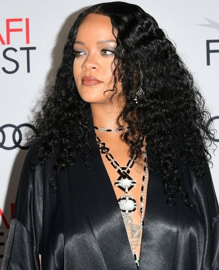 Rihanna wears David Webb's Streamline necklace with black onyx links, brilliant-cut diamonds, 18K gold, and platinum