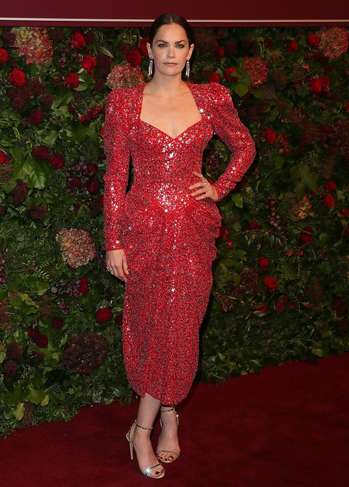 Ruth Wilson in a festive red embellished Michael Kors dress