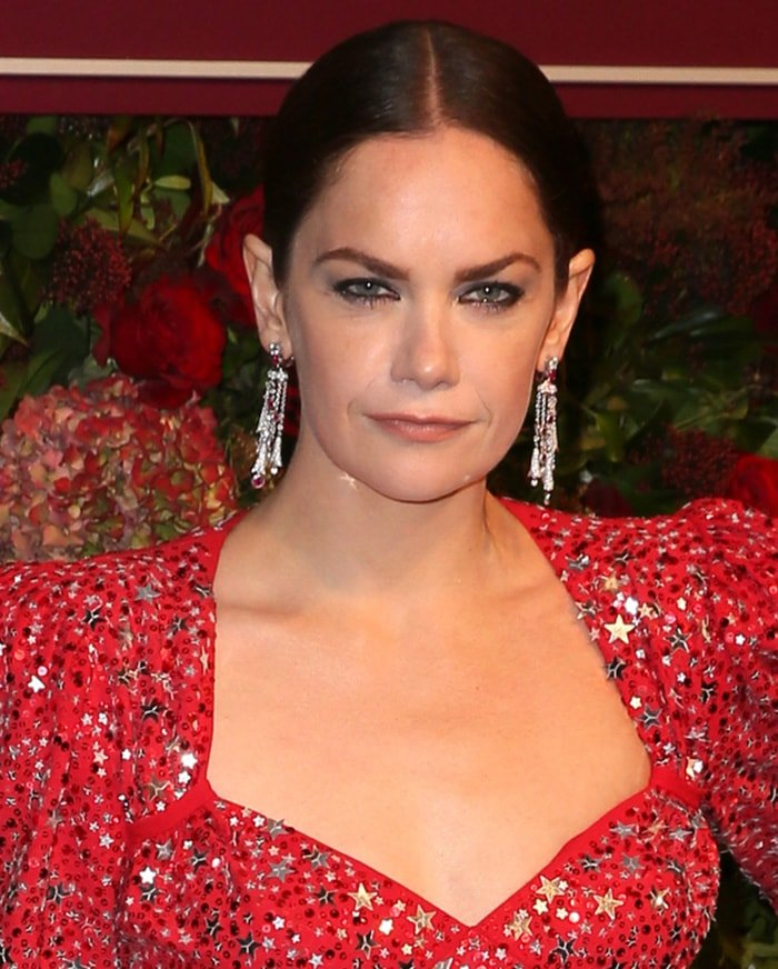 Ruth Wilson looks fierce with dark eyeliner and center-parted updo