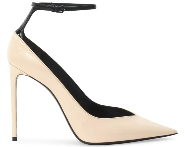 A slender black ankle strap perched on a creamy patent leather pump sets a fashion-forward tone, as does this style's notched pointy toe and setback stiletto