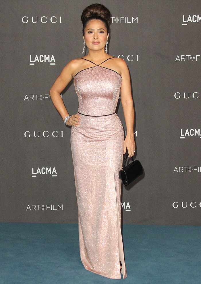 Salma Hayek shows off her figure in a crystal-embellished Gucci gown
