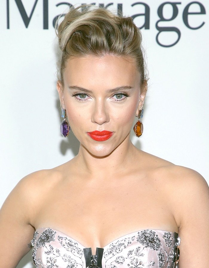 Scarlett Johansson wears a fauxhawk and scarlet lip shade