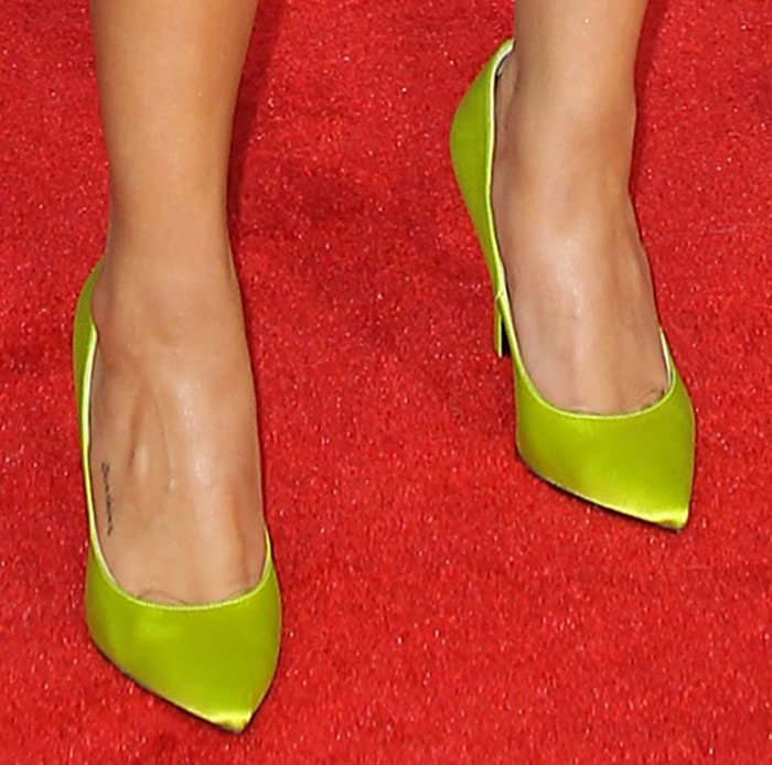 Selena Gomez shows off her Sunshine foot tattoo in lime green Versace pumps