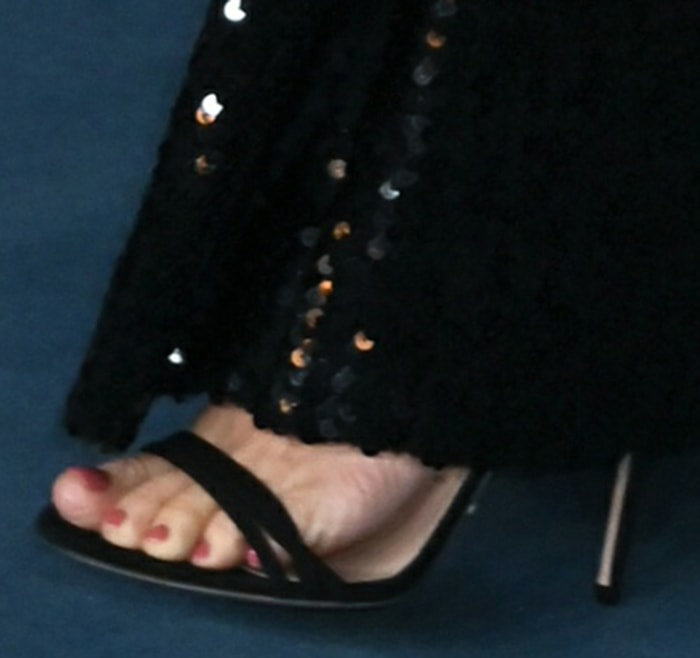 Sienna Miller shows off her red pedicure in Gucci heels