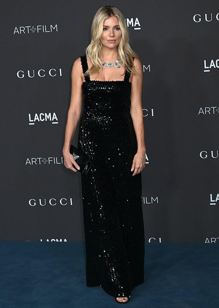 Sienna Miller wears an understated Gucci sequin-embellished black dress