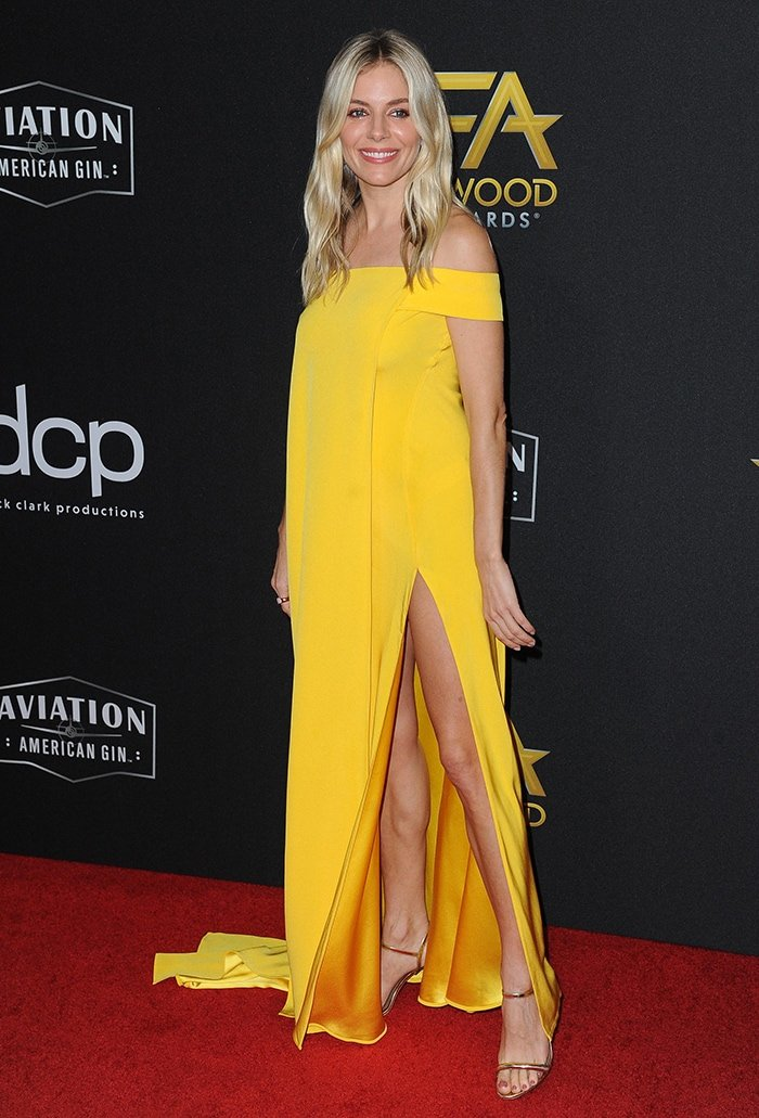 Sienna Miller steals the spotlight in a marigold yellow Cong Tri spring 2020 gown