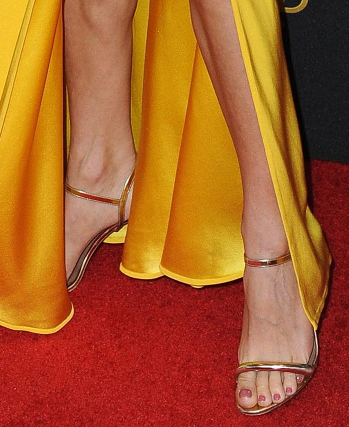 Sienna Miller shows off her toenail polish in Tabitha Simmons sandals