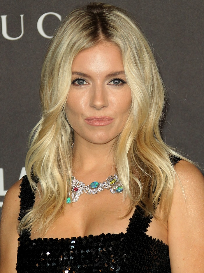 Sienna Miller wears soft makeup and styles her hair in loose waves
