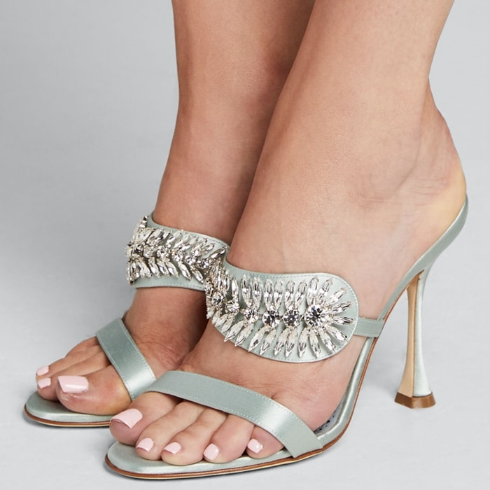 A slide style sandal gets a gorgeous lift with a curvy heel and glittering crystals that catch and reflect the light