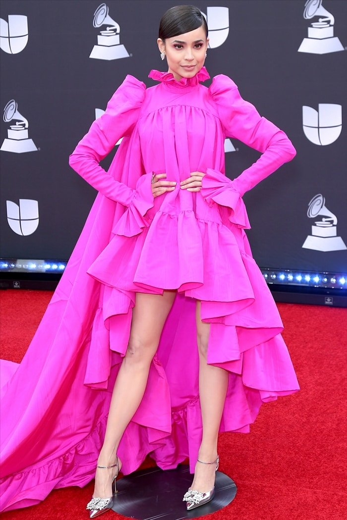 Sofia Carson flashed her legs in a bubblegum pink dress and buckled Roger Vivier slingback pumps