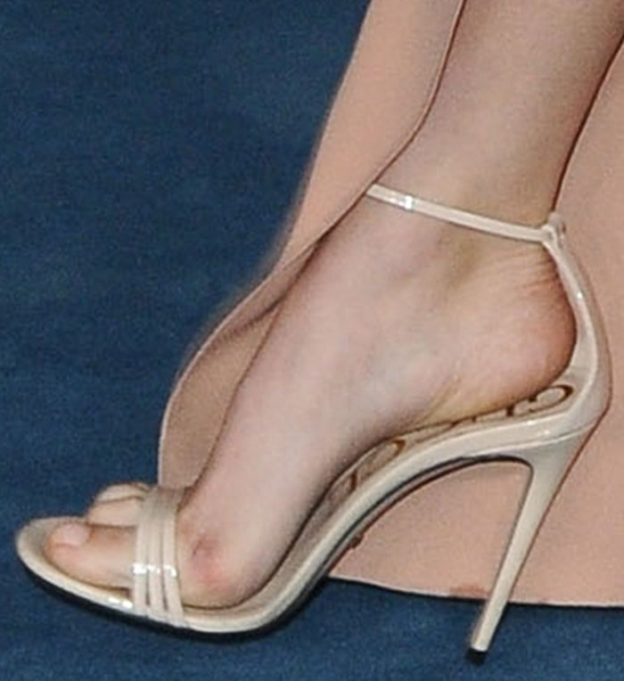 Suki Waterhouse teams her nude pink dress with beige Gucci sandals