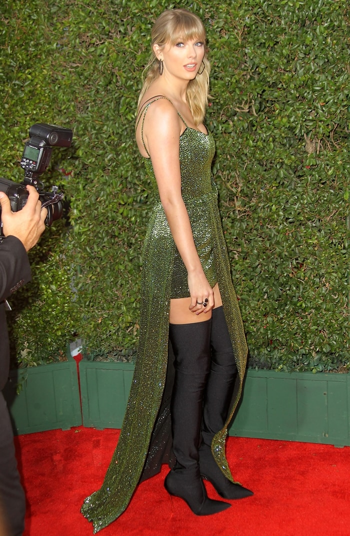 Taylor Swift wore a custom beaded green gown by Julien Macdonald