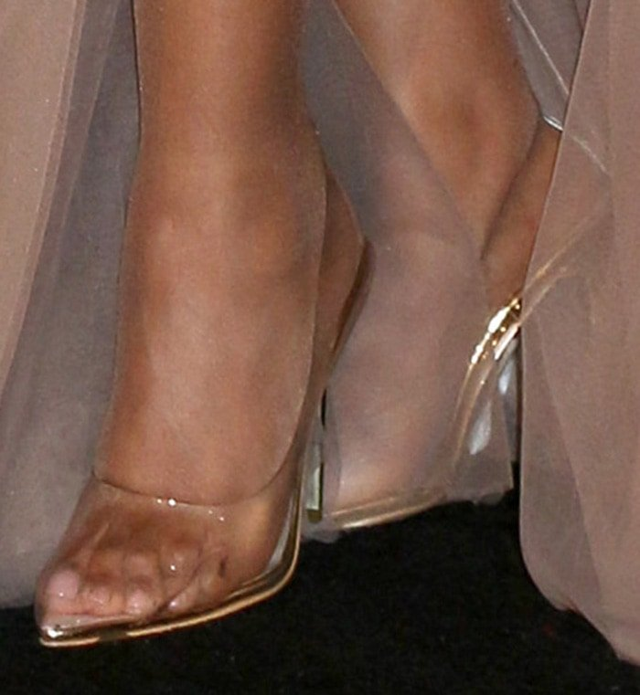 Toni Braxton's toes look uncomfortable in PVC pumps