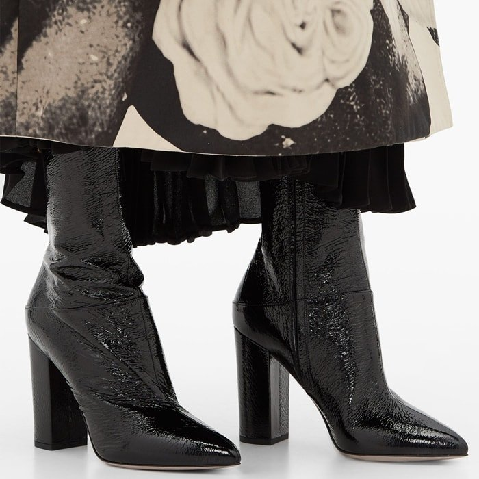 Valentino's black Ringstud ankle boots will add a commanding finish to both smart and casual ensembles