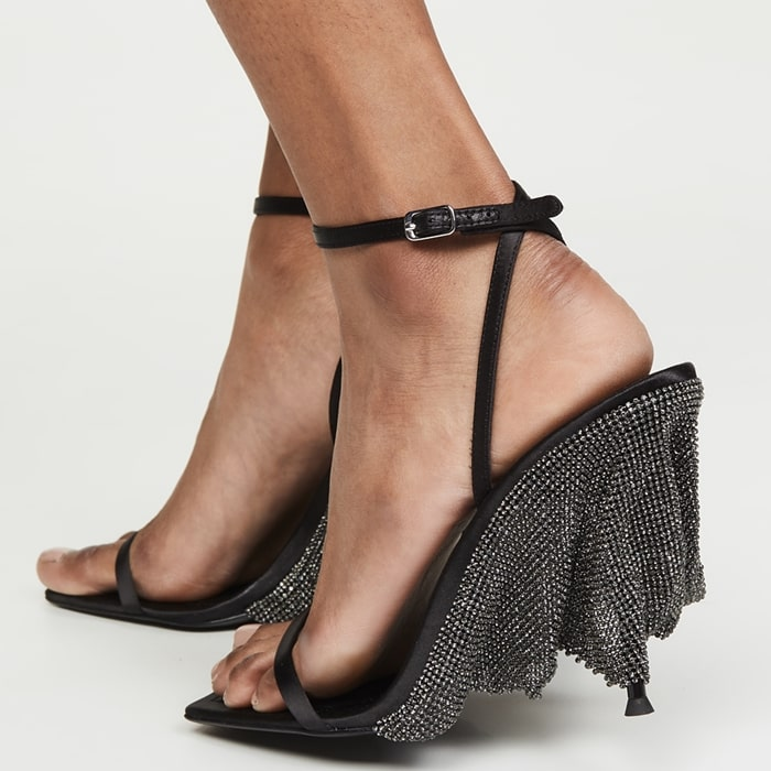 These strappy Blake sandals have an open square toe and dazzling crystals blanketing the heel