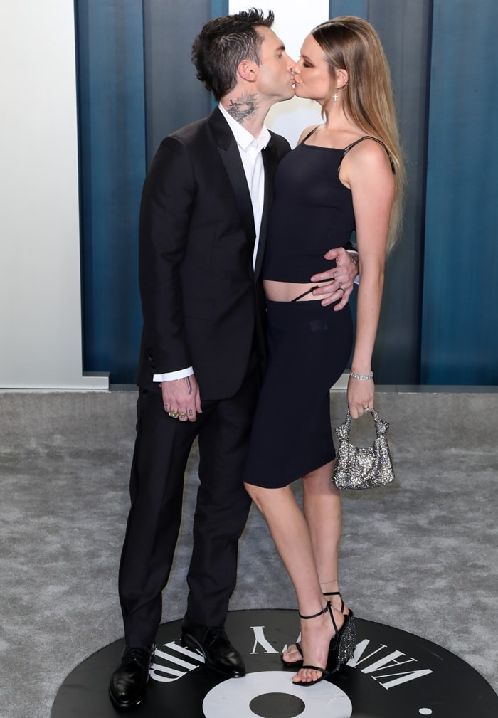 Adam Levine and Behati Prinsloo kissing at the 2020 Vanity Fair Oscar Party