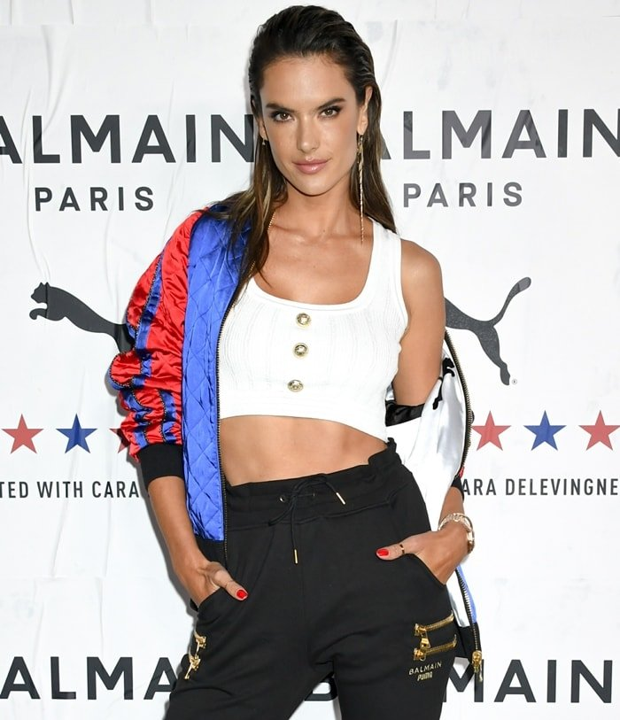 Alessandra Ambrosio's cropped tank is finished with a delicate ribbed texture and is elevated with polished goldtone embossed buttons