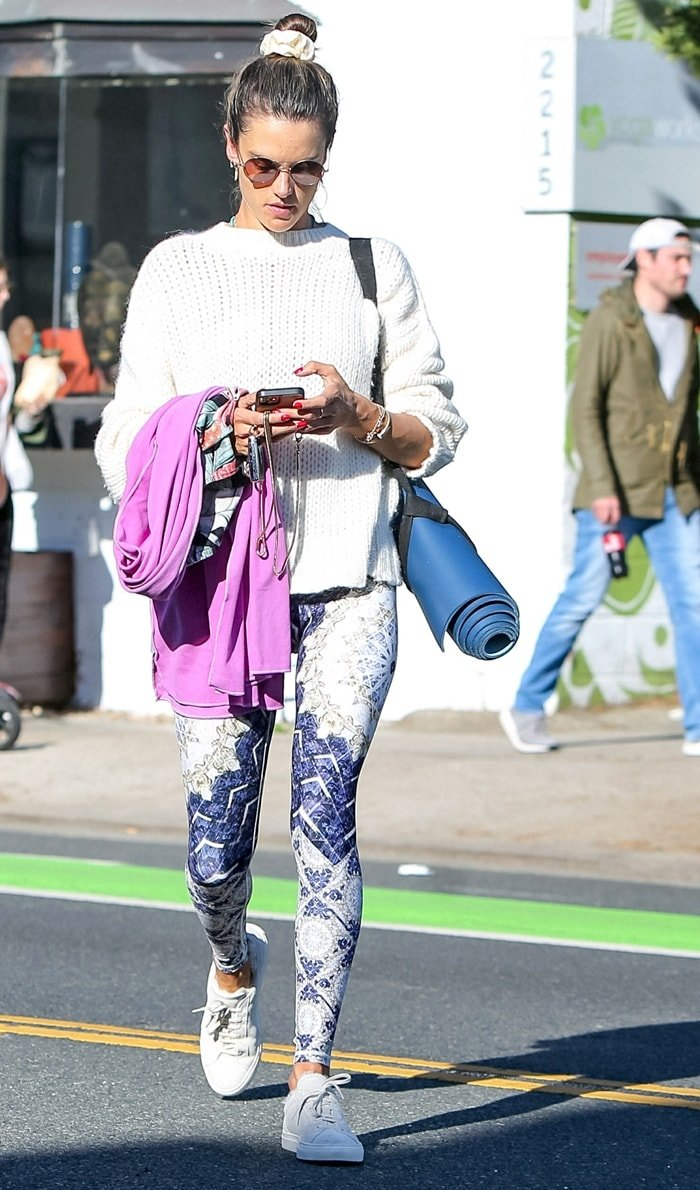 "Alessandra Ambrosio leaves a yoga class in Wolven's skin-tight ""Reverie"" leggings"