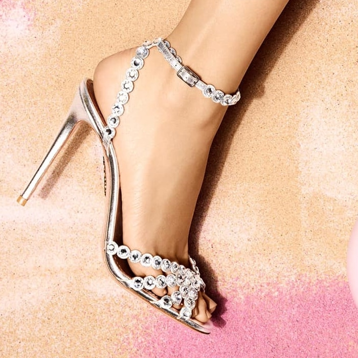 These sandals hae been made in Italy from silver leather and dusted with faceted crystals that shimmer under even the dimmest light