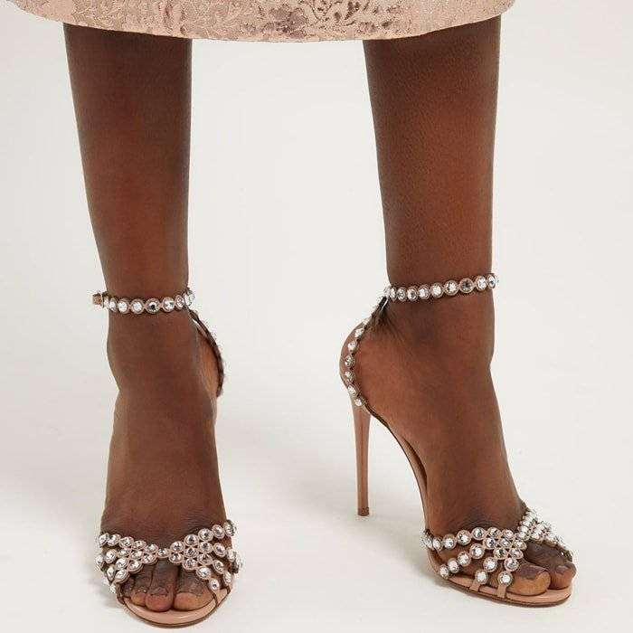 These sandals are made with scalloped blush leather straps and glisten with rows of sparkly crystals