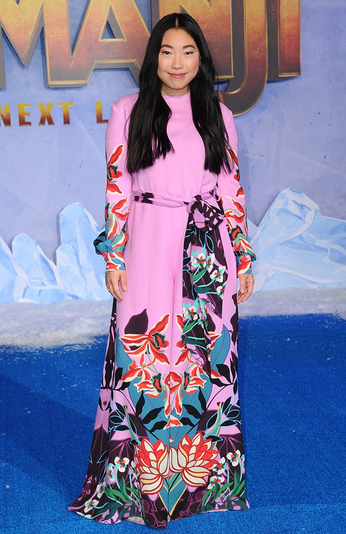 Awkwafina brightens up the blue carpet in a pink Valentino jumpsuit