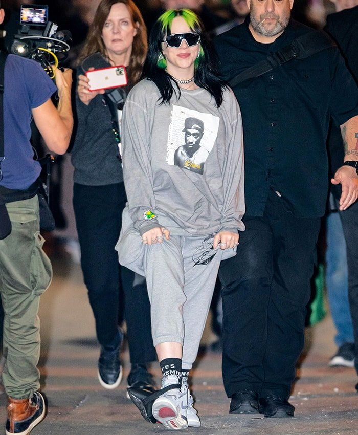 "Billie Eilish in gray sweat pants and Nike Jordan Legacy 312 ""Wolf Grey"" sneakers outside Jimmy Kimmel Live studios on November 21, 2019"