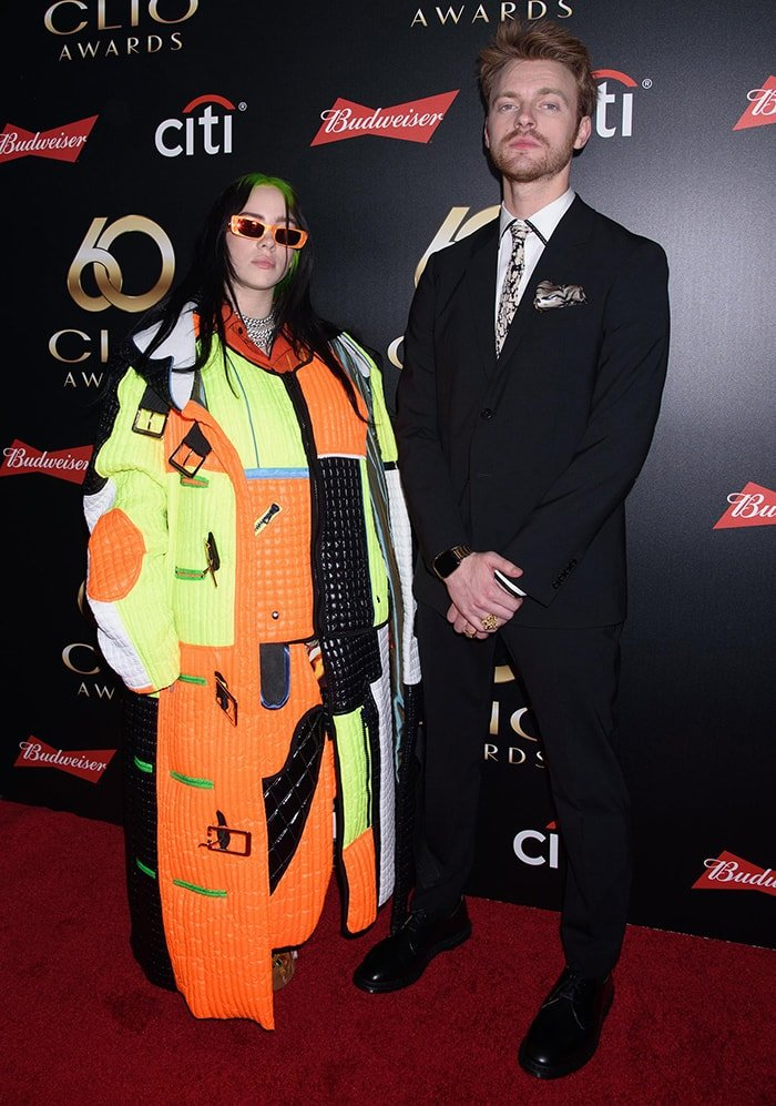 Billie Eilish attends the 60th Annual Clio Awards in Keep Going Rubik's Cube suit with her brother Finneas O'Connell