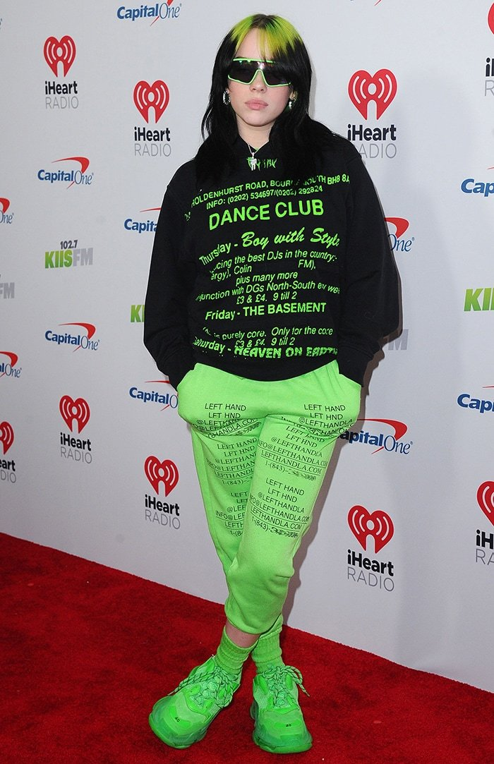 Billie Eilish in MISBHV green sweater, Left Hand LA pants and Balenciaga Triple S Sneakers at KIIS FM's iHeartRadio Jingle Ball 2019 on December 6, 2019