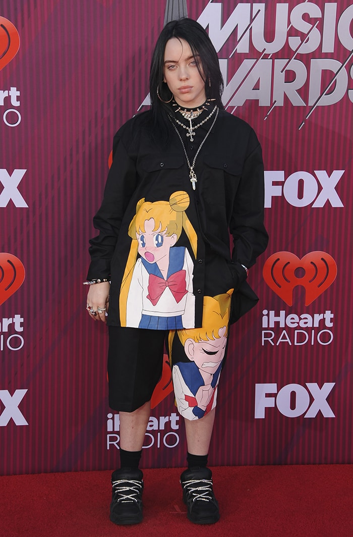 Billie Eilish in a custom Slumpy Kev 'Sailor Moon' outfit and Under Armour x ASAP Rocky SRLo black sneakers