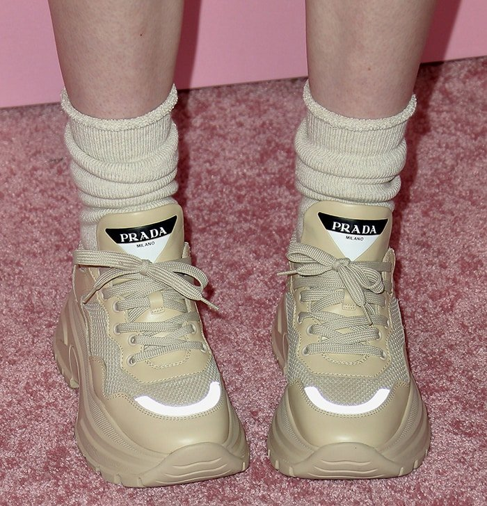Billie Eilish's Prada chunky sneakers in a subtle quartz-pink hue sitting on a 75mm light rubber tread sole