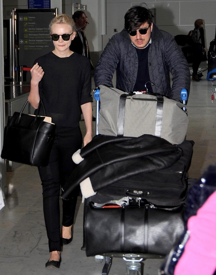 Carey Mulligan arrives with her husband Marcus Mumford at Nice airport ahead of the 66th Annual Cannes Film Festival