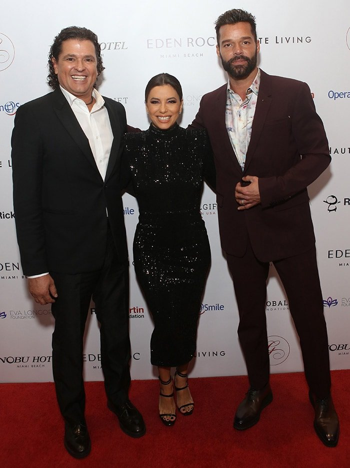 Carlos Vives, Eva Longoria, and Ricky Martin at Global Gift Foundation USA's 2019 Global Gift Gala held at the Eden Roc Hotel during the Art Basel in Miami on December 5, 2019