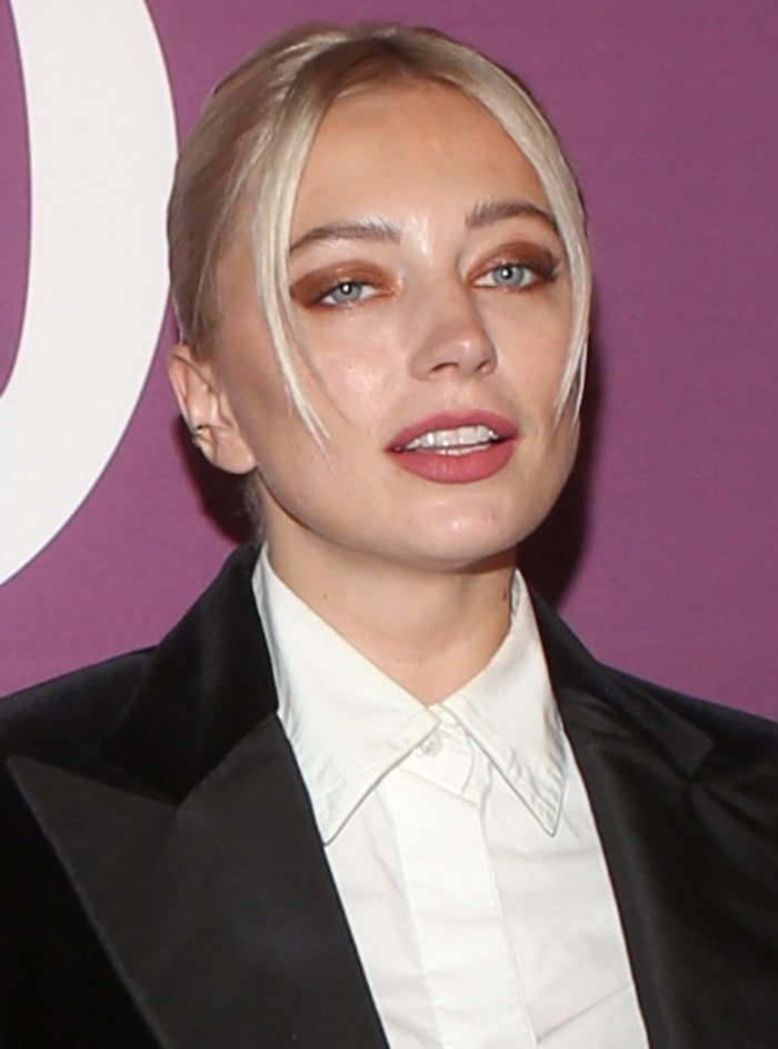 Caroline Vreeland wears a chic updo with face-framing fringe and bronzed eyeshadow