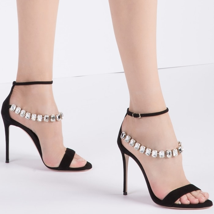 Black suede Julia Lily Rose sandals featuring an open toe, a toe strap, an ankle strap with a side buckle fastening, crystal embellishments and a high stiletto heel