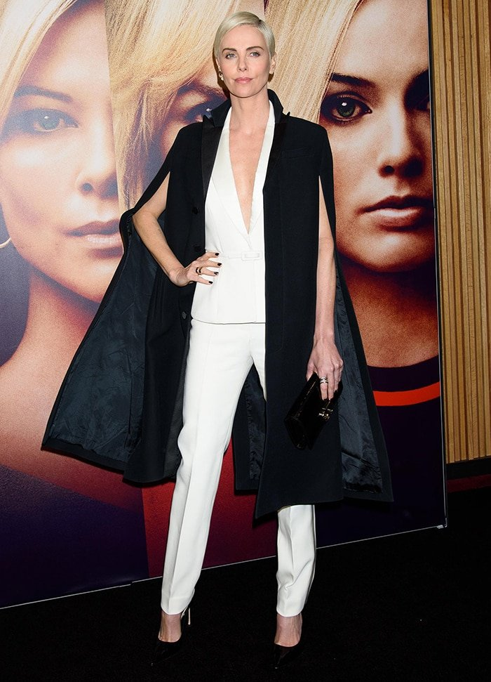 Charlize Theron in Dior suit and cape at the New York screening of Bombshell held at Lincoln Center on December 16, 2019