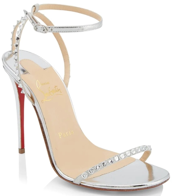 Dazzling metallic stiletto sandals adorned with crystal spike trim at the heel and across the toe