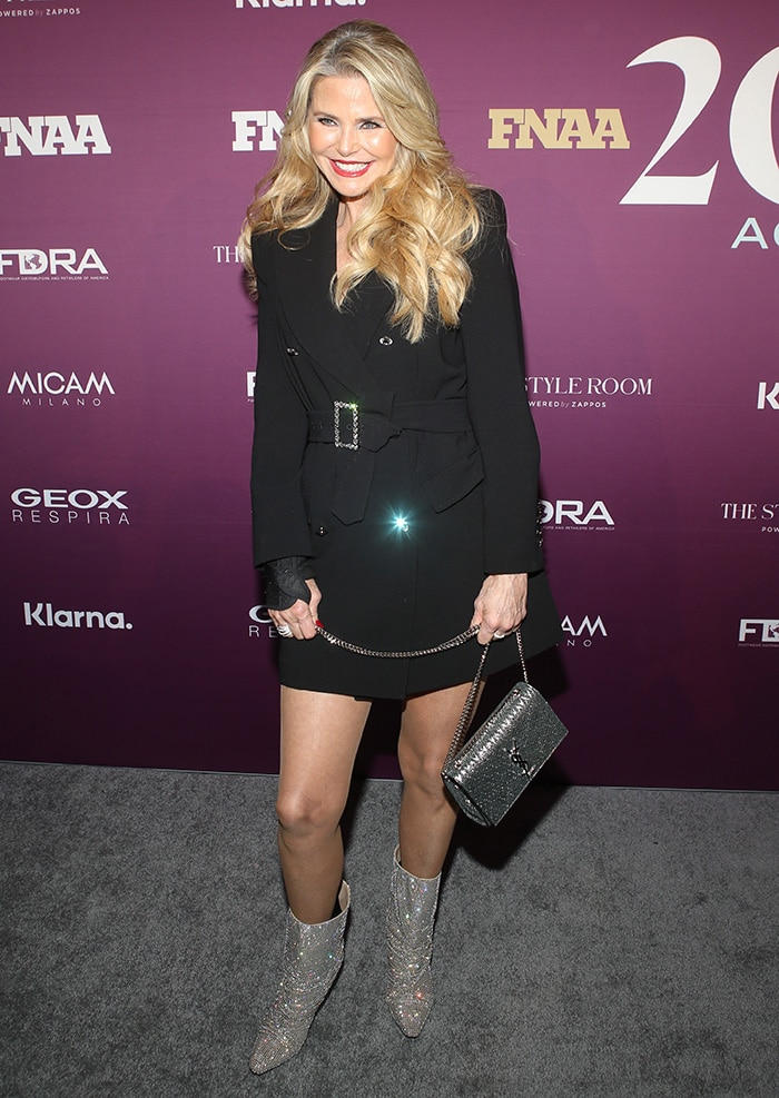 Christie Brinkley shows off her legs in a Tom Ford coat dress at the 33rd Annual Footwear News Achievement Awards