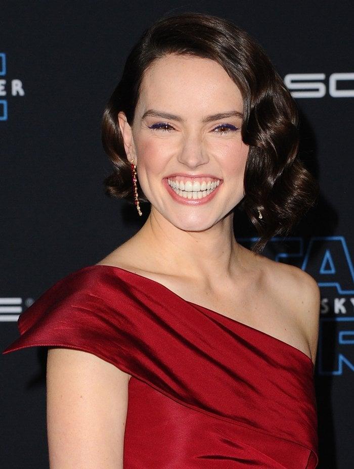 Daisy Ridley's white teeth and Anita Ko ruby and diamond drop rope earrings