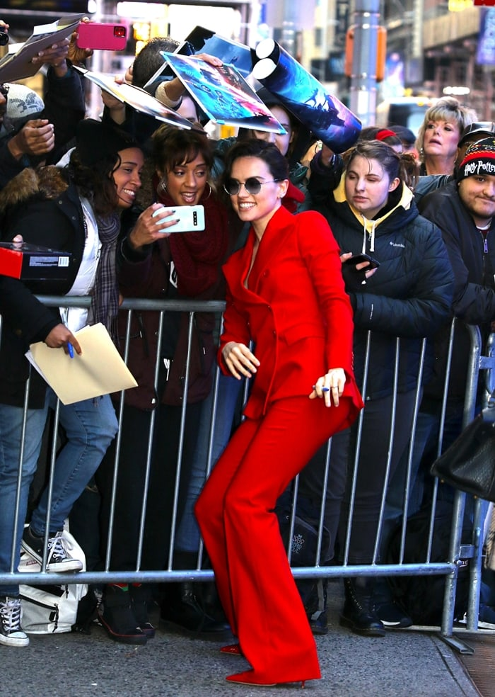 Daisy Ridley stuns in a red suit while signing autographs at Good Morning America