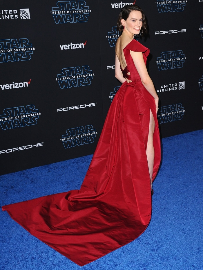 Daisy Ridley in a custom crimson red hue Oscar de la Renta dress at the premiere of Star Wars: The Rise of Skywalker