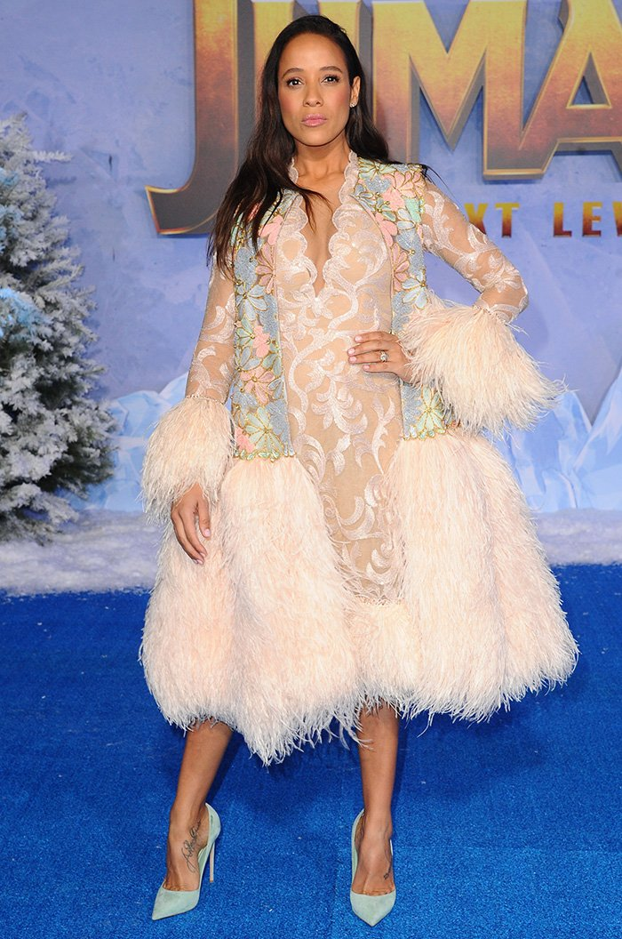 Dania Ramirez inSebastian Gunawan feathered dress and vest coat