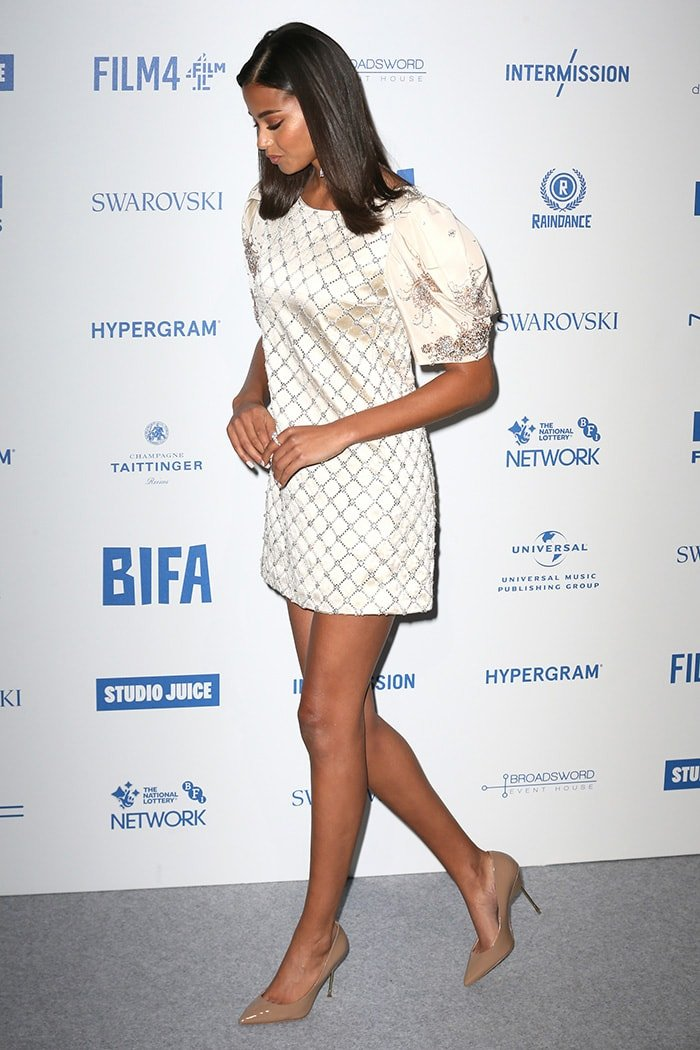 Ella Balinska shows off her long legs in Miu Miu mini dress