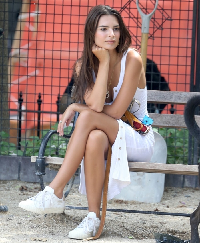 Emily Ratajkowski wears a white dress and matching perforated Adidas Everyn sneakers