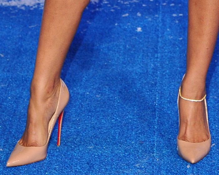Eniko Parrish shows off her feet in Christian Louboutin nude patent pumps