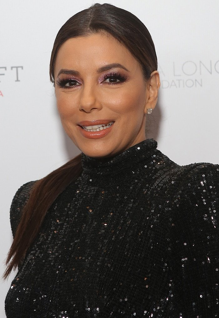 Eva Longoria wears glittery pink eyeshadow and center-parted ponytail