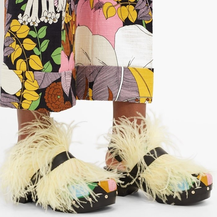 La DoubleJ evokes a flamboyant mood with the whisper-weight yellow feathers adorning these black Jean clogs, created in collaboration with Fabrizio Viti