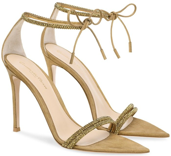 Made of iridescent gold suede, this pointy toe sandal is set on a 105mm solid heel