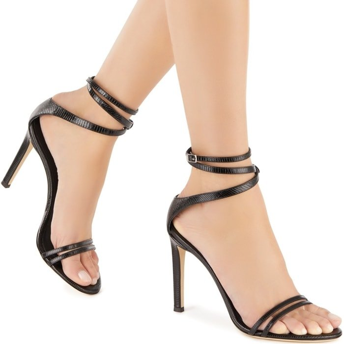 These high-heel, black python-print leather sandals feature a front strap formed by two thinner straps, and a wrap ankle strap