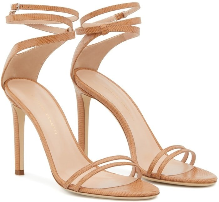 These high-heel, nude python-print leather Catia sandals feature a front strap formed by two thinner straps, and a wrap ankle strap